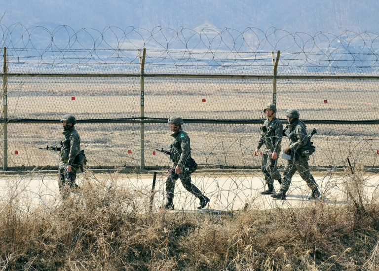 [Photo: A file photo of soldiers of the Republic of Korea Armed Forces on patrol. Source:  AFP/JUNG YEON-JE ]