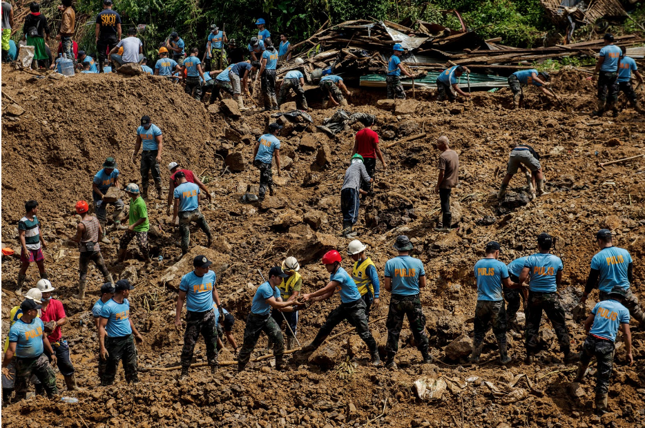 Emergency workers conducting a search and rescue operation in Itogon, Philippines. (Source: The New York Times)