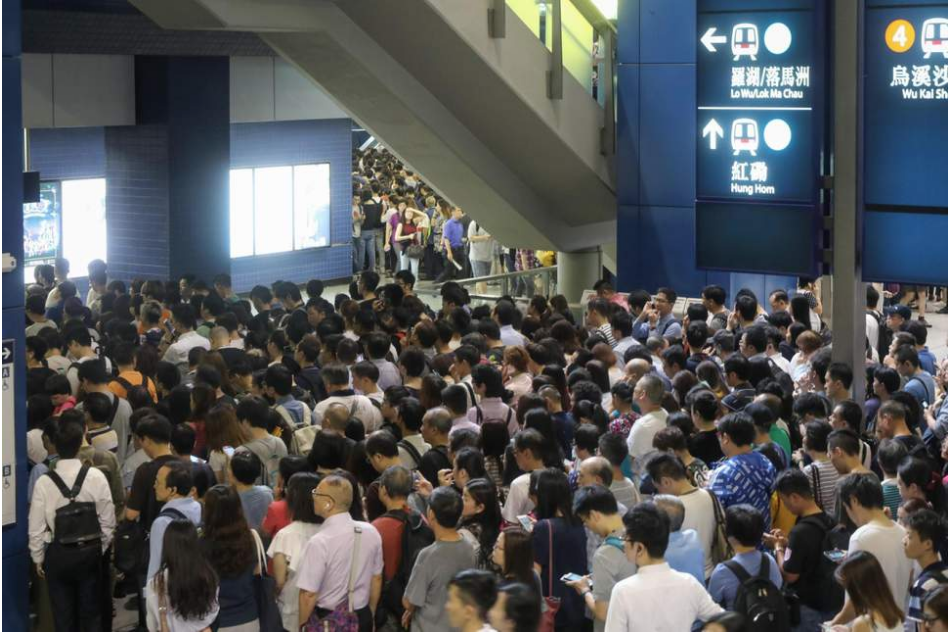 Commuters in Hong Kong were left stranded as the city's transportation system was largely paralyzed. (Source: Evening Standard)