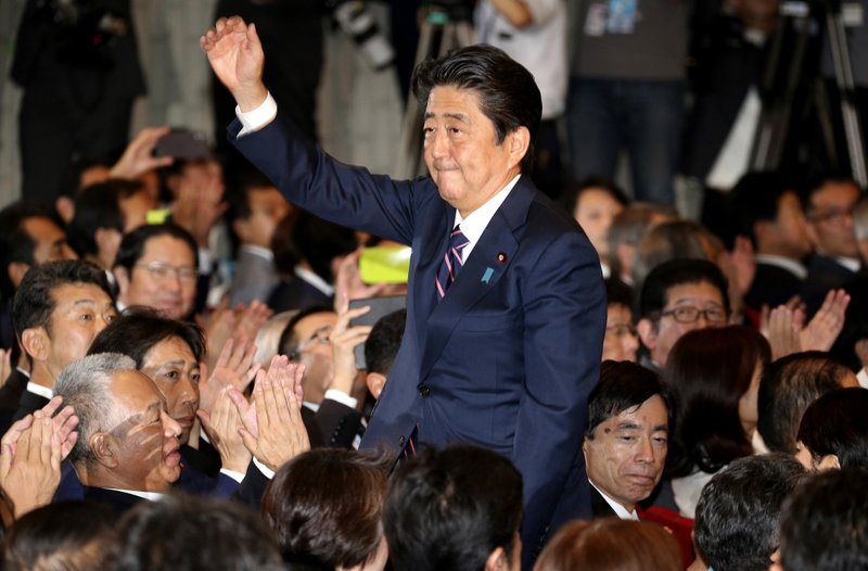 Incumbent LDP President Shinzo Abe acknowledges fellow party members' applause after being announced the winner of the party presidential election at its headquarters in Tokyo on Sept. 20, 2018. Photo:  Koji Sasahara/AP Photo