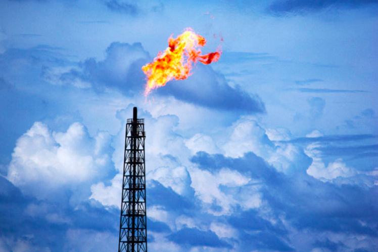 Photo: 1 Gas flaring on a power plant. Source:    Flickr