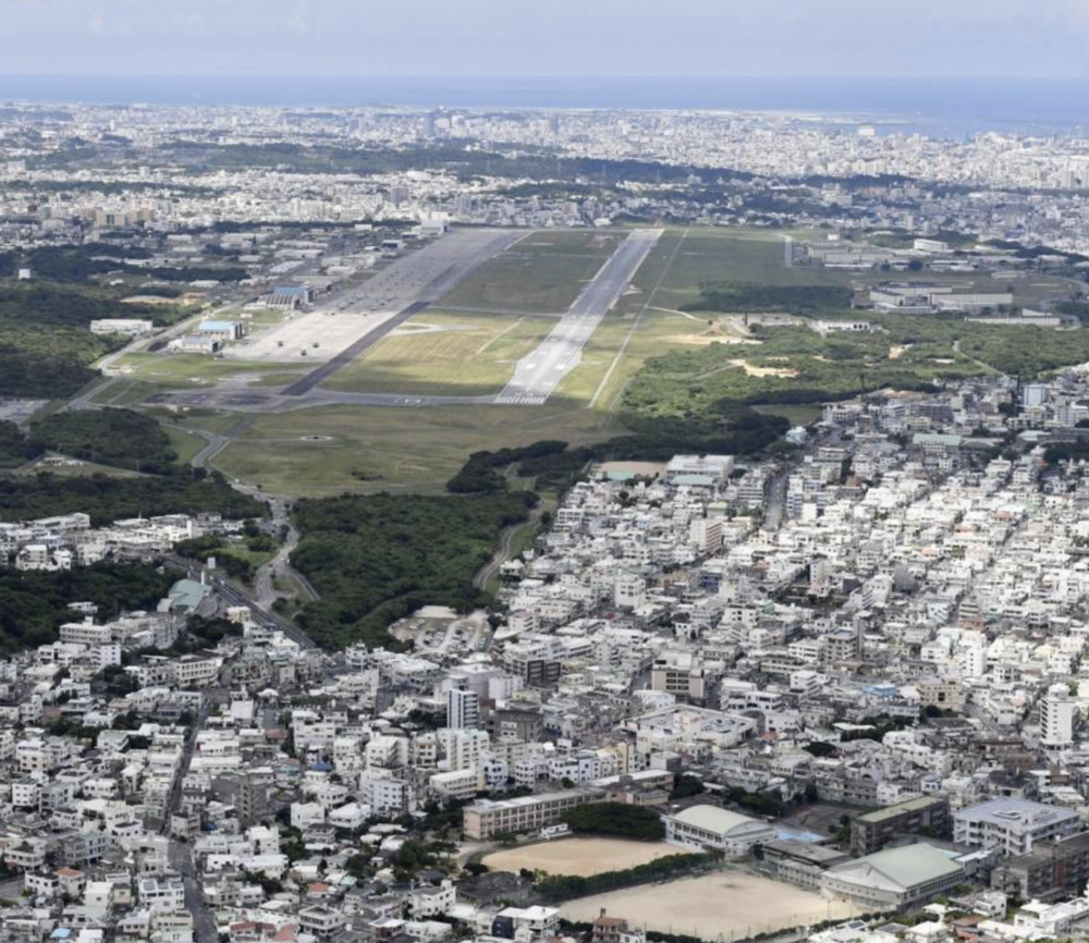 An aerial photo, dated July 2017, of US Marine Corps Air Station Futenma on Okinawa Island. Note the density of buildings on both sides of the runways. Credit:  KYODO