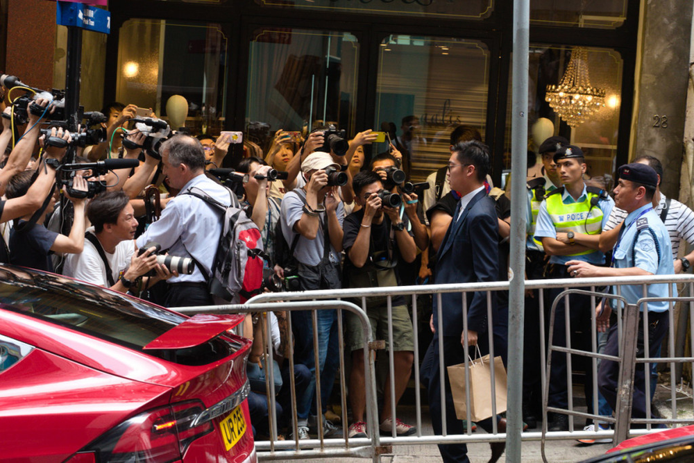 Andy Chan, leader of the Hong Kong National Party, is swarmed by the press on the streets of Hong Kong after the city's government outlawed the HKNP. Credit:  Hong Kong Citizen News