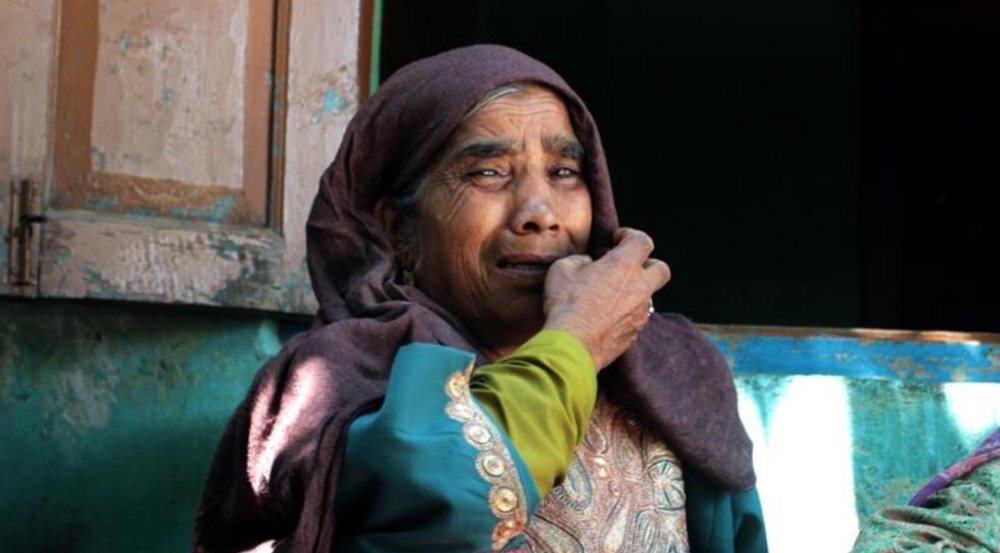 Mother of a slain police officer, Muhammad Yaqoob Shah, mourning her son's death.  Photo: Rifat Fareed/Al Jazeera