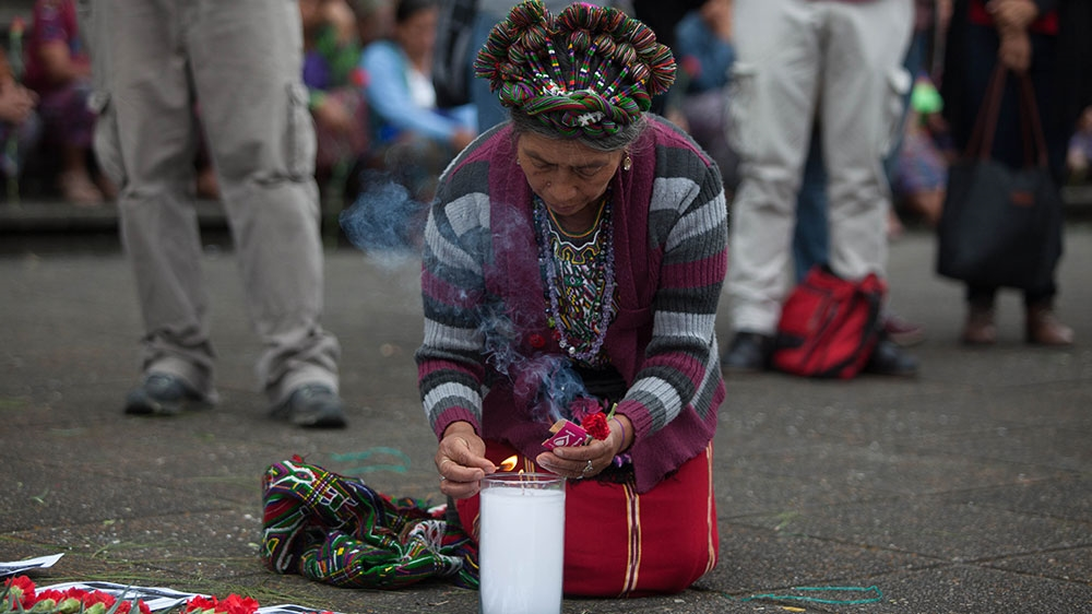 Family members, survivors, and supporters remembered Guatemala's decades long civil war outside the Supreme Court before the trial on Wednesday. Photo:  Aljazeera .