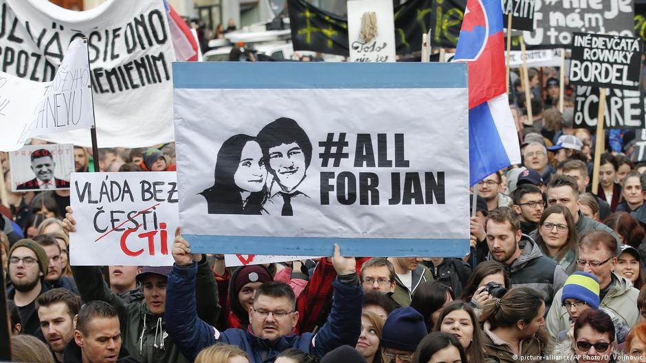 Demonstrators in the streets of Bratislava celebrate the resignation of Prime Minister Robert Fico on Mar. 15, 2018. Photo:  D. Voijnovic/AP Photo