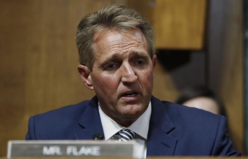 Senator Jeff Flake of Arizona speaks about an FBI investigation on Friday. Photo:  AP
