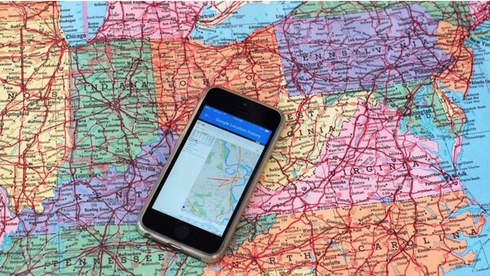 IPhone resting on a map of America. Photo:    Matt Elliott/CNET