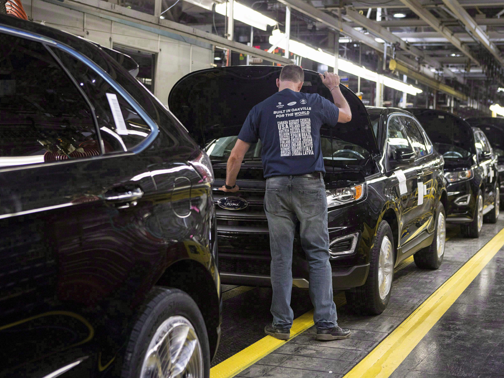 Ford Assembly Line in the United States   Photo : Chris Young/Canadian Press