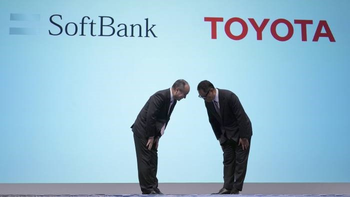 SoftBank chairman Masayoshi Son and Toyota president Akio Toyoda at the two companies' joint press conference in Tokyo. Photo: AP.