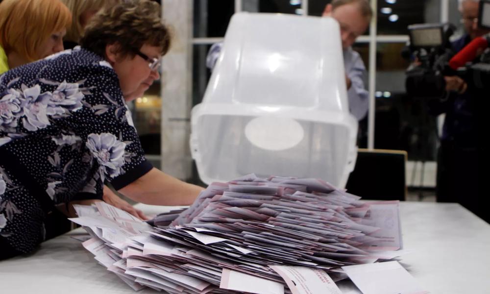 Election officials count ballot papers in Latvia's Oct. 7, 2018, parliamentary election. Photo:  Valda Kalnina/EPA
