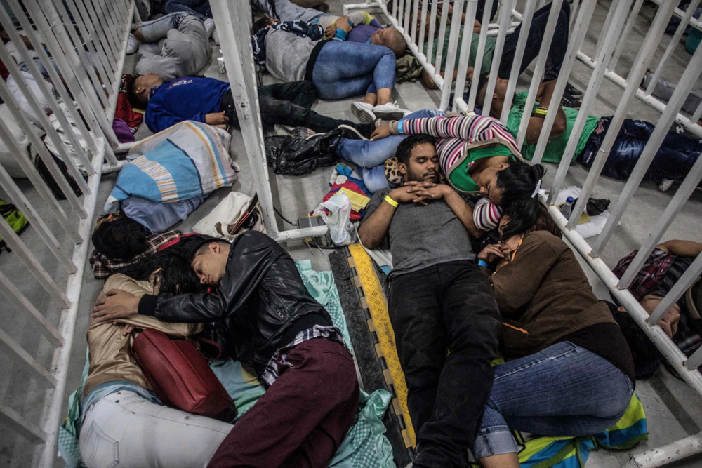 Venezuelan migrants living in Medellin, Colombia, sleep as they wait to attend a job fair on Sept. 27 Credit:  Foreign Policy