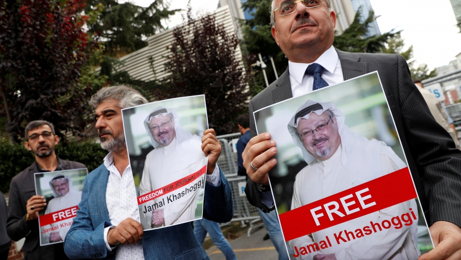 Human rights activists and friends of Saudi journalist Jamal Khashoggi hold his pictures during a protest outside the Saudi Consulate in Istanbul, Turkey. Oct. 8, 2018.  Credit: Murad Sezer/Reuters