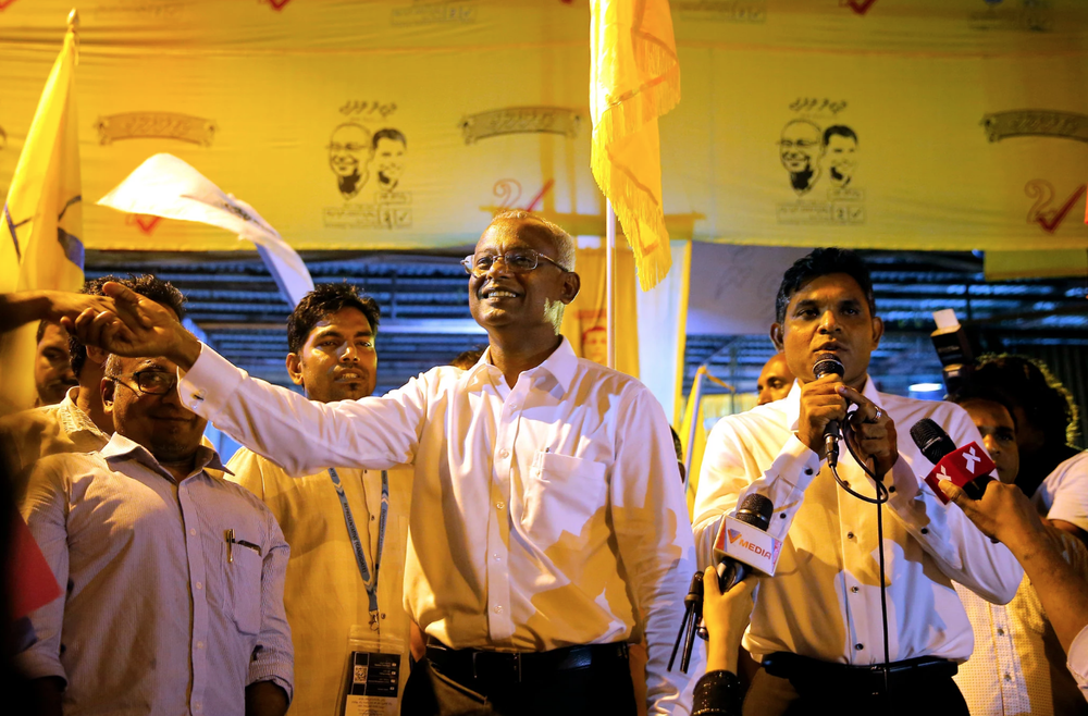 Solih, center, at a campaign with his running mate, Faisal Naseem, on the right, at a rally in Male, Maldives on September 24.  Photo: Eranga Jayawardena/Associated Press