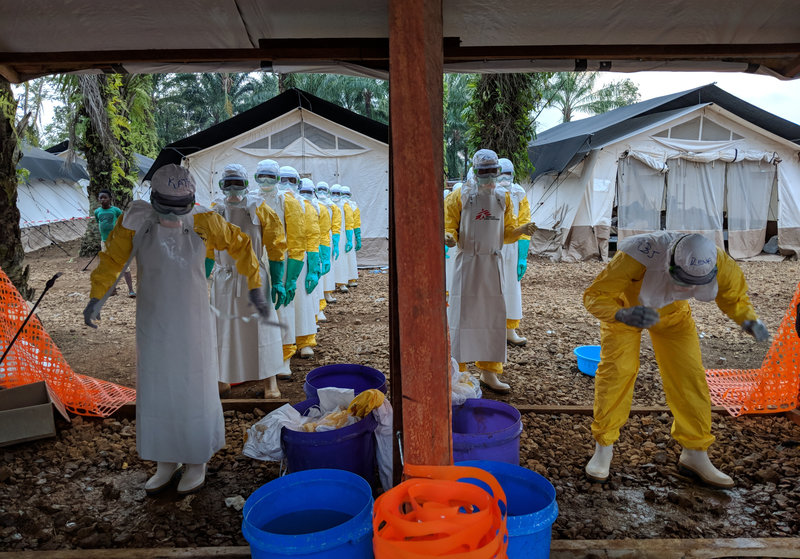 In Mangina, a town in the DRC, health workers take off their protective gear at one of the treatment centers set up Doctors without Borders. Photo: Karin Huster/ NPR