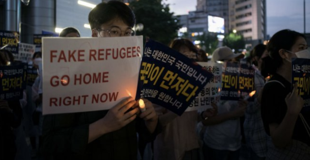 Anti-refugee protesters in Seoul on June 30, 2018. Credit:  Ed Jones/AFP