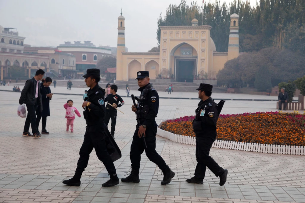 Chinese armed police patrol outside of the Id Kah Mosque in Kashgar's old town in Xinjiang Uyghur Autonomous Province, located in China's western frontier. Photo:  Ng Han Guan/Associated Press