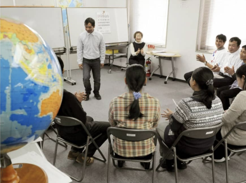 A photo, dated February 2011, of refugees from Myanmar who entered Japan under the third-country resettlement program participating in Japanese language classes in Tokyo's Shinjuku Ward. Credit:  Kyodo