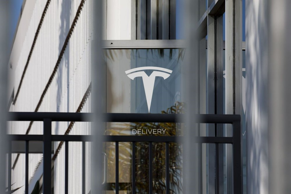 Tesla earned its third quarterly profit at a record $311.5 million. Photo:  Patrick T. Fallon - Bloomberg News .