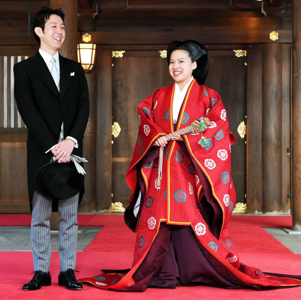 Japanese Princess Ayako clothed in ceremonial wedding attire (right) standing next to her groom Kei Moriya (left) at their wedding on Monday 29, October 2018. Credit:  THE ASAHI SHIMBUN