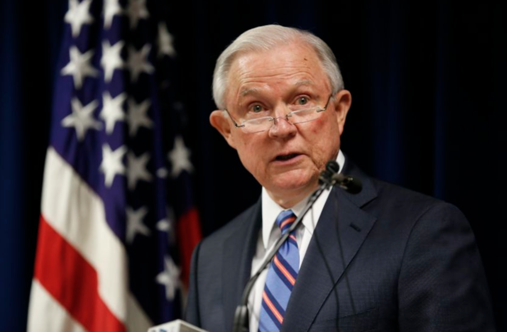 Attorney General Jeff Sessions at a press conference discussing the incident.  Credit: Adam Cairns \  AP