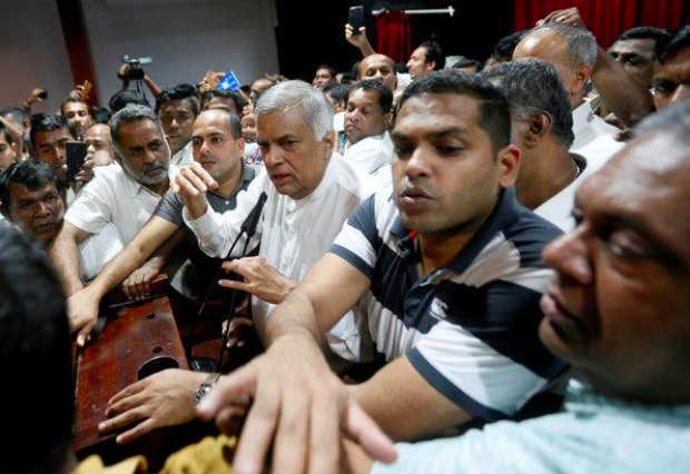 Ranil Wickremesinghe, Sri Lanka's original prime minister, expressing his views to a crowd in Sri Lanka's capital city, Colombo; Photo:  New York Times