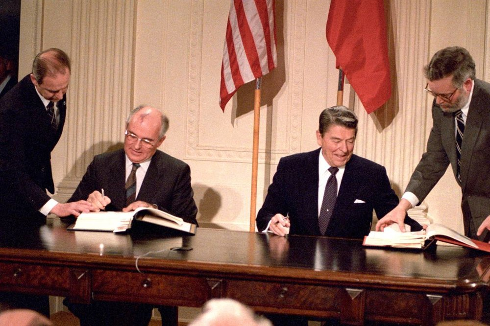 U.S. President Ronald Reagan, right, and Soviet President Mikhail Gorbachev sign the INF Treaty in the White House on December 8, 1987.    Credit: Dennis Paquin/Reuters