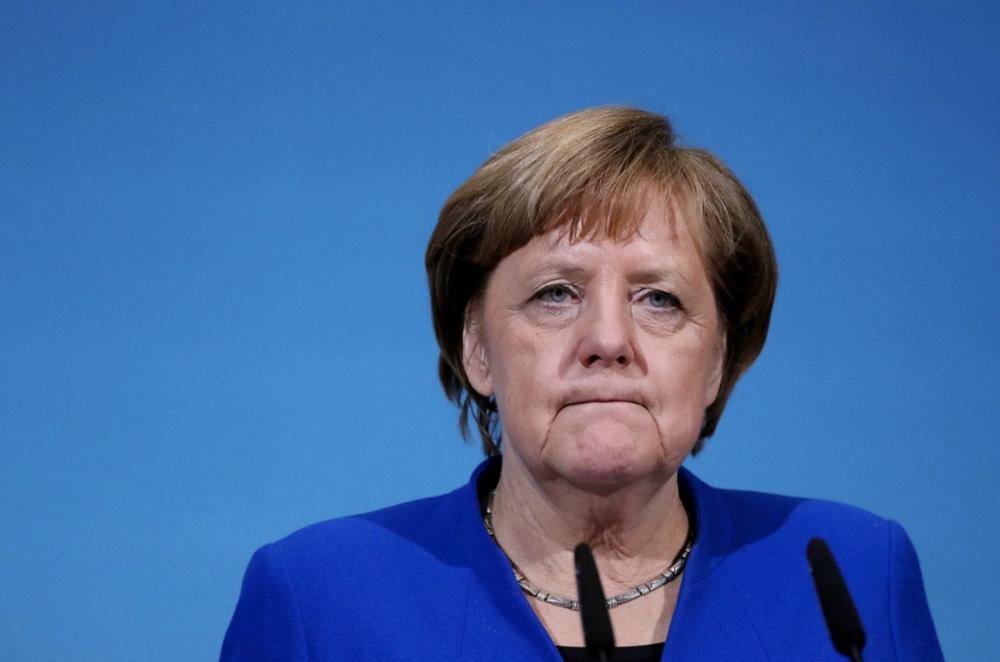 Angela Merkel announces she will not seek re-election. Photo:  Krisztian Bocsi/Bloomberg News
