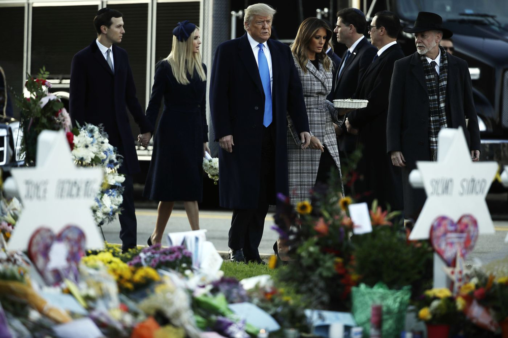 President Donald Trump and his family visit a memorial outside One Tree Synagogue  Photo: Matt Rourke/AP