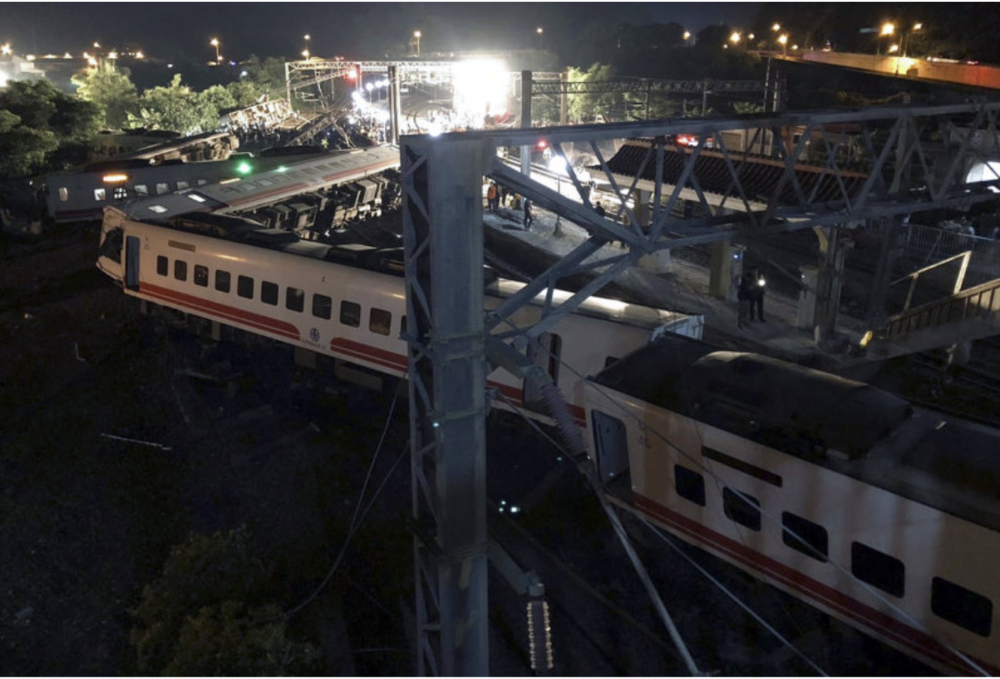 Scene of the train accident near Su'ao, Yilan County, in Taiwan's northeast. All eight carriages jumped the rails with five overturning, killing 18 and injuring scores of others. Credit:  Taiwan Railways Administration/AP
