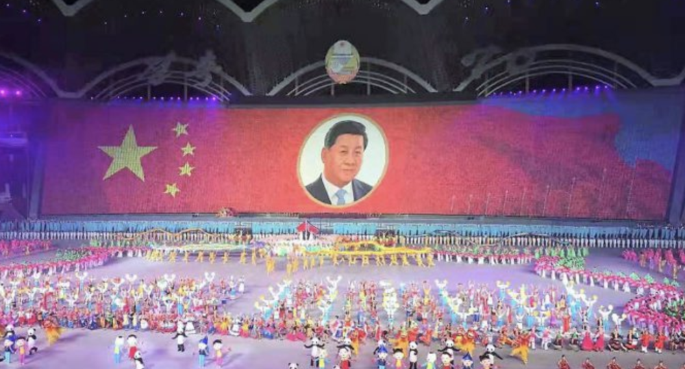 "Chinese President Xi Jinping is rendered by thousands of children holding colored boards as a ""human pixel"" screen at the Glorious Country performance on Nov. 4, 2018, which concluded the Mass Games held in Pyongyang. Photo:  NK News ."