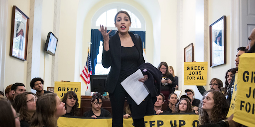 Alexandria Ocasio-Cortez speaking to protestors in front of Pelosi's office. Credit: Sarah Silbiger/ Redux