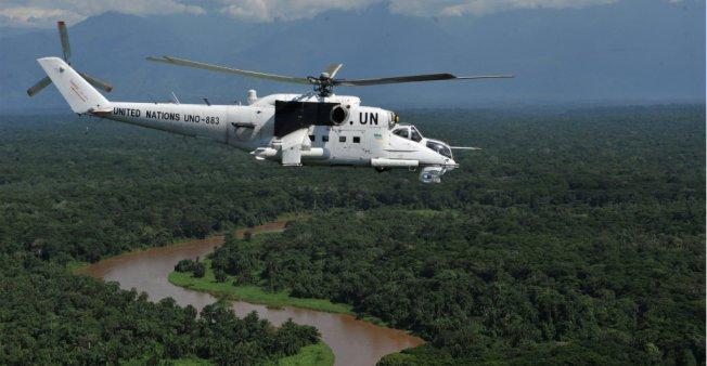 A UN helicopter flies over the DRC near Beni  Photo:  Oleksandr Klymenko/Reuters