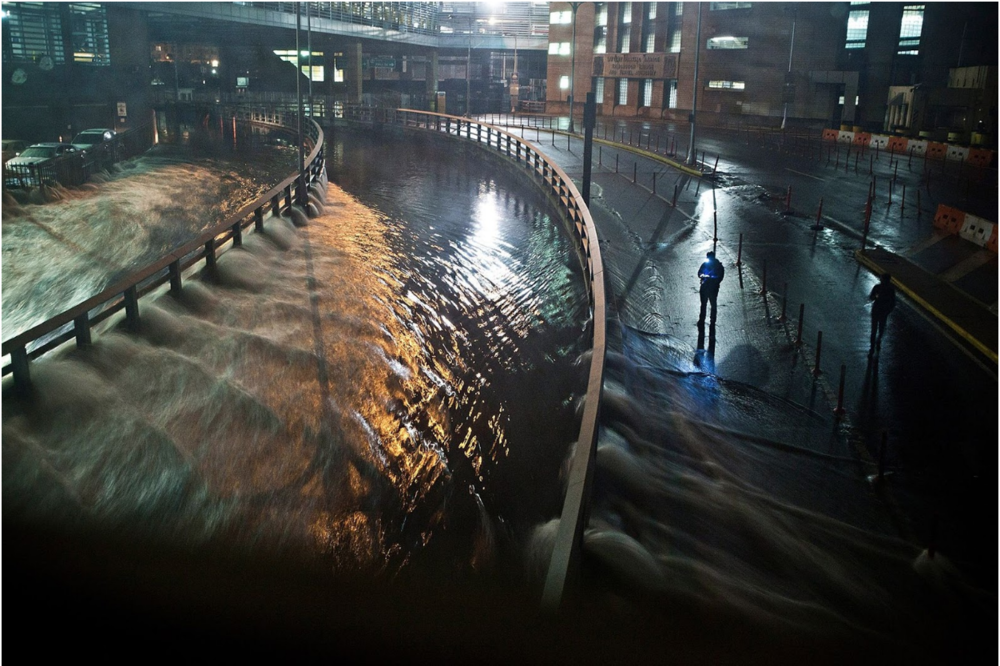 Flooding in the Financial District of New York City during Hurricane Sandy, a 2012 hurricane that flooded many neighborhoods in New York. Photo: Andrew Burton/ Getty Images