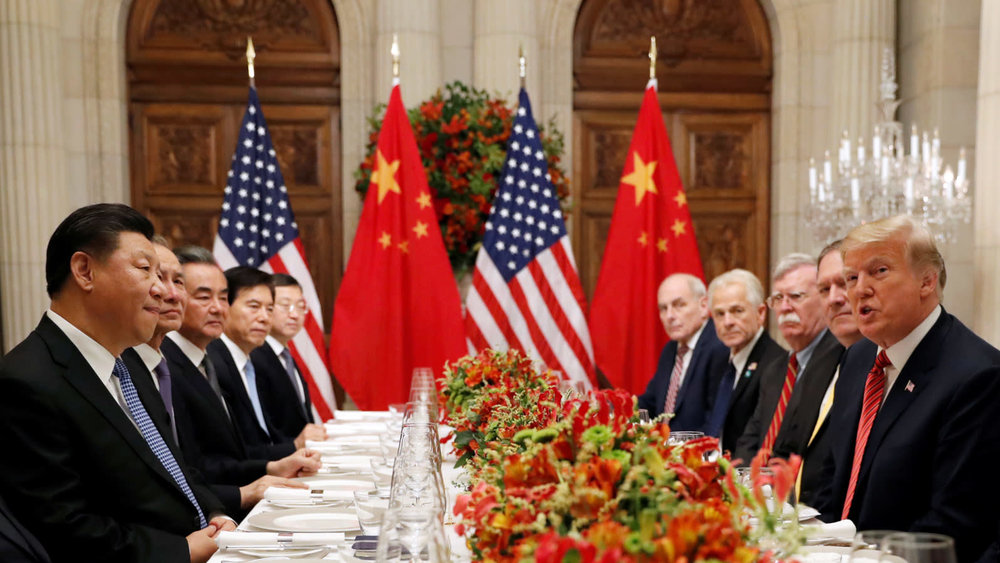 US President Donald Trump (right) leads the US delegation at a working dinner with the Chinese delegation led by Chinese President Xi Jinping (left). Credit:  Reuters