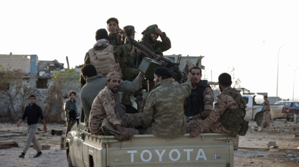 A group of general Khalifa Haftar's forces ride in a truck in the Benina area, east of Benghazi. Credit:  Reuters