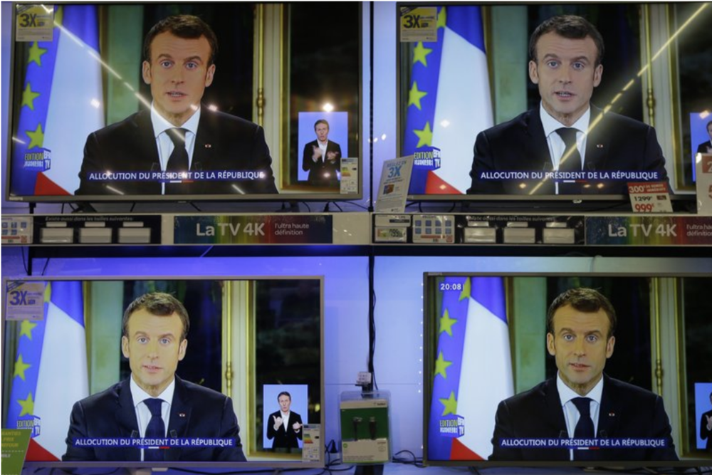 French President Emmanuel Macron addressing the protesters via a televised speech. Credit:  Associated Press/Claude Paris