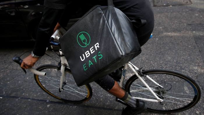 Uber Eats will serve as the delivery method for Starbucks' coffee. Photo:  Reuters .