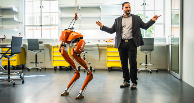 A photo of Aaron Ames with the walking robot Cassie.  Photo Credit:(Caltech)/St.Thomas University