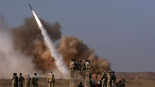 Iranian Revolutionary Guards personnel watch the launch of a Zelzal missile in Iran. June 28, 2011  Credits: AP