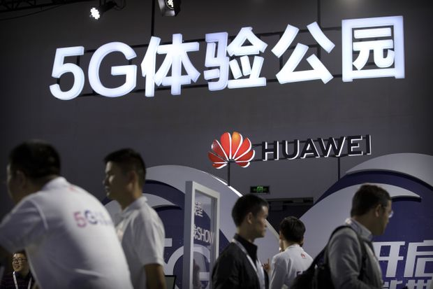 Huawei's 5G technology display booth at the PT Expo held in Beijing, China, on Sept. 26, 2018.  Photo:  Mark Schiefelbein/AP
