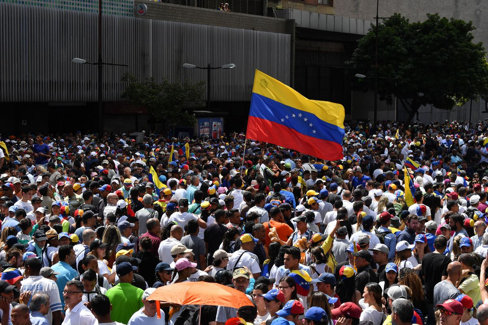Opposition supporters marching in protest against the Maduro government on Jan. 23, 2019. Photo:  Yuri Cortex/AFP via Vox .
