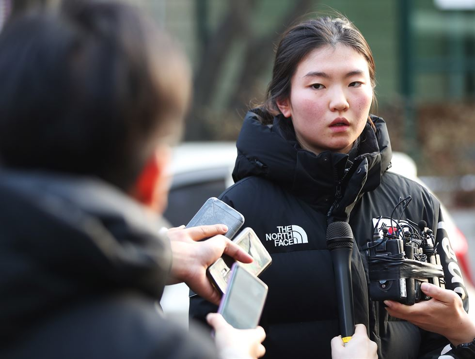 Two-time Olympic short-track speed skating champion Shim Suk-hee is interviewed by reporters outside Suwon District Court after she testified against her former coach in December 2018. Credit:  Yonhap