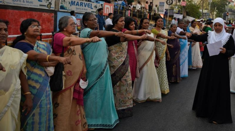 Thousands of women joined to form a 620-km human chain in support of the court's decision. Photo:  RS Iyer/AP