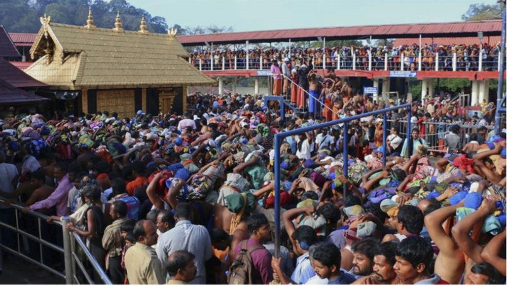 Thousands of devotees gather at the Sabarimala Temple in Kerala, India. Photo:  Hareesh Kumar AS/AP.