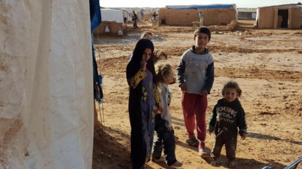 Children in Rukban camp in southeast Syria, where 40,000 displaced Syrians live and rely on humanitarian aid. Credit:  Al Jazeera