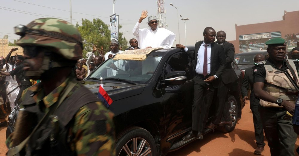 President Muhammadu Buhari greeting supporters in his hometown. Photo:  Luc Gnago/Reuters .