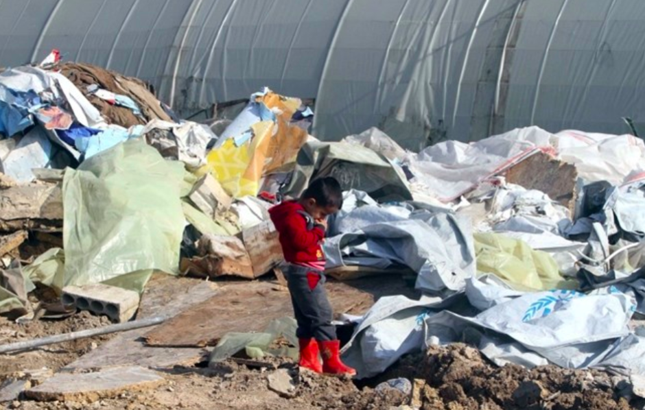 A boy stands among the rubble of a Syrian refugee camp that was bulldozed in Zahrani in Lebanon on the weekend of Feb. 23-24th.  Photo : Mohammed Zaatari/The Daily Star