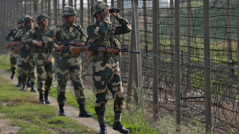 Indian Border Security Forces stationed along a border fence with Pakistan on February 26, 2019; Photo: Mukesh Gupta,  Reuters