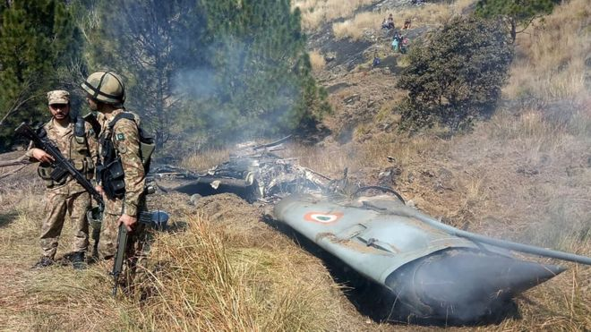 Pakistani soldiers stand by what they claim is wreckage from an Indian jet; Photo:  BBC